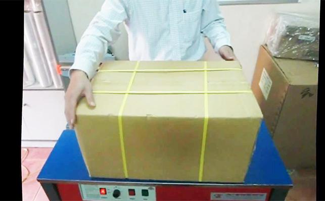 Máy quấn đai thùng